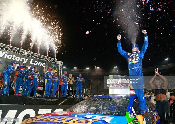 Kyle Busch driver of the MM's Caramel Toyota celebrates in victory lane after winning the Monster Energy NASCAR Cup Series Bass Pro Shops NRA Night...