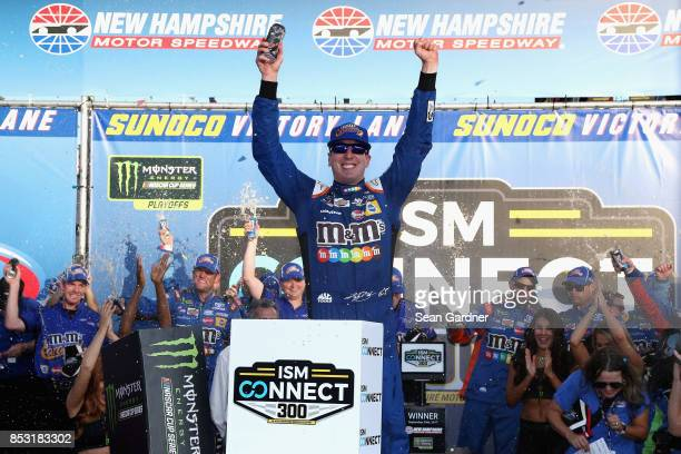 Kyle Busch driver of the MM's Caramel Toyota celebrates in Victory Lane after winning the Monster Energy NASCAR Cup Series ISM Connect 300 at New...