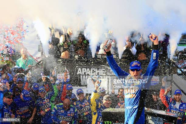 Kyle Busch driver of the MM's Caramel Toyota celebrates in Victory Lane after winning the Monster Energy NASCAR Cup Series Apache Warrior 400...