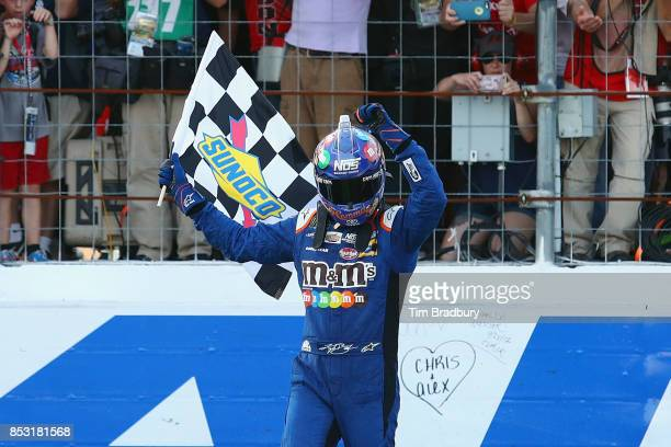 Kyle Busch driver of the MM's Caramel Toyota celebrates winning the Monster Energy NASCAR Cup Series ISM Connect 300 at New Hampshire Motor Speedway...