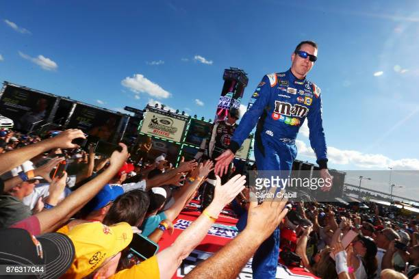 Kyle Busch driver of the MM's Caramel Toyota greets fans during driver introductions for the Monster Energy NASCAR Cup Series Championship Ford...