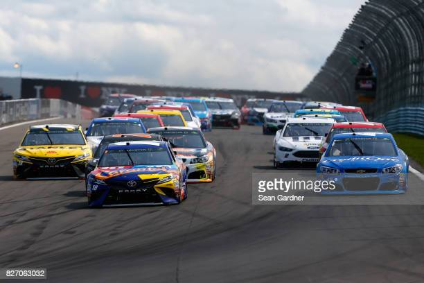 Kyle Busch driver of the MM's Caramel Toyota leads a pack of cars during the Monster Energy NASCAR Cup Series I Love NY 355 at The Glen at Watkins...