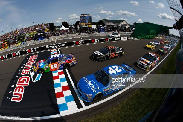 Kyle Busch, driver of the M&M's Caramel Toyota, leads during the Monster Energy NASCAR Cup Series I Love NY 355 at The Glen at Watkins Glen...