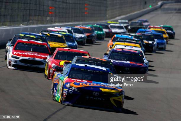 Kyle Busch driver of the MM's Caramel Toyota leads the field into turn one during the Monster Energy NASCAR Cup Series Overton's 400 at Pocono...