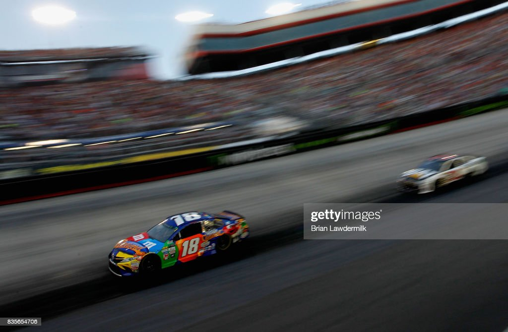 Kyle Busch, driver of the #18 M&M's Caramel Toyota, races during the Monster Energy NASCAR Cup Series Bass Pro Shops NRA Night Race at Bristol Motor Speedway on August 19, 2017 in Bristol, Tennessee.