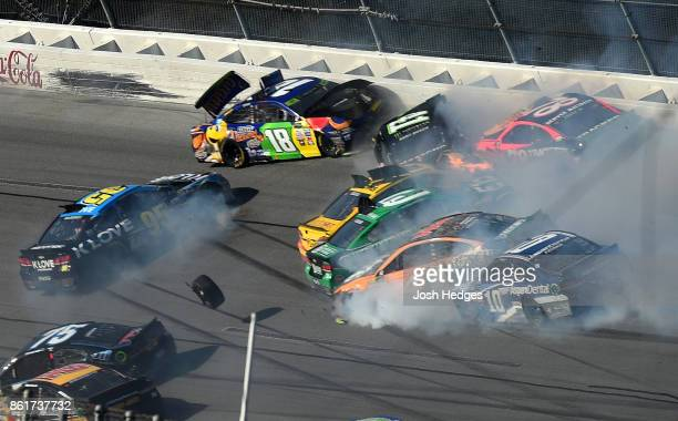 Kyle Busch driver of the MM's Caramel Toyota spins the Monster Energy NASCAR Cup Series Alabama 500 at Talladega Superspeedway on October 15 2017 in...
