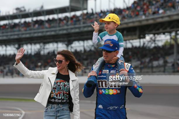 Kyle Busch driver of the MM's Caramel Toyota walks with his son Brexton and wife Samantha prior to the start of the Monster Energy NASCAR Cup Series...
