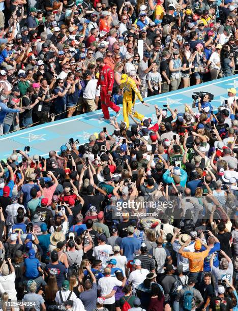 Kyle Busch driver of the MM's Chocolate Bar Toyota and Corey LaJoie driver of the Old Spice Ford wave to fans during driver intros before the Monster...