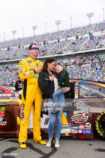 Kyle Busch driver of the MM's Chocolate Bar Toyota stands with his wife Samantha and son Brexton during the Monster Energy NASCAR Cup Series Advance...