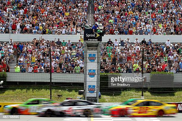 Kyle Busch, driver of the M&M's Crispy Toyota, and Kevin Harvick, driver of the Jimmy John's/Budweiser Chevrolet, lead the field to the green flag...