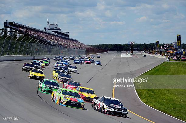 Kyle Busch, driver of the M&M's Crispy Toyota, and Kevin Harvick, driver of the Jimmy John's/Budweiser Chevrolet, lead the field at the start of the...