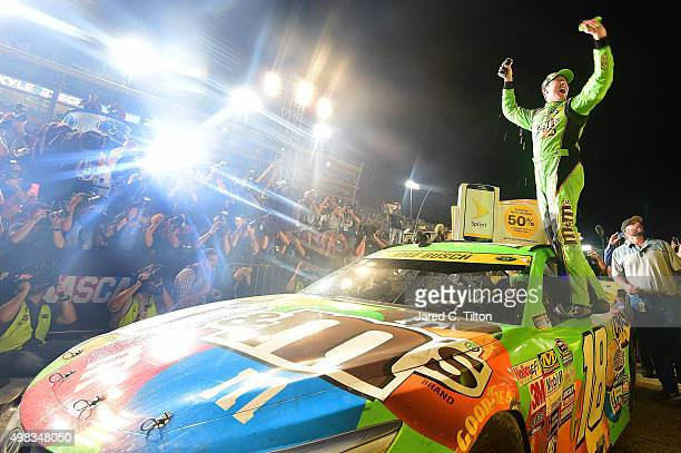 Kyle Busch, driver of the M&M's Crispy Toyota, celebrates winning the series championship in Victory Lane after the NASCAR Sprint Cup Series Ford...