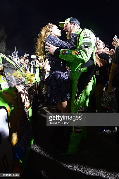 Kyle Busch driver of the MM's Crispy Toyota celebrates with his wife Samantha in Victory Lane after winning the series championship and the NASCAR...