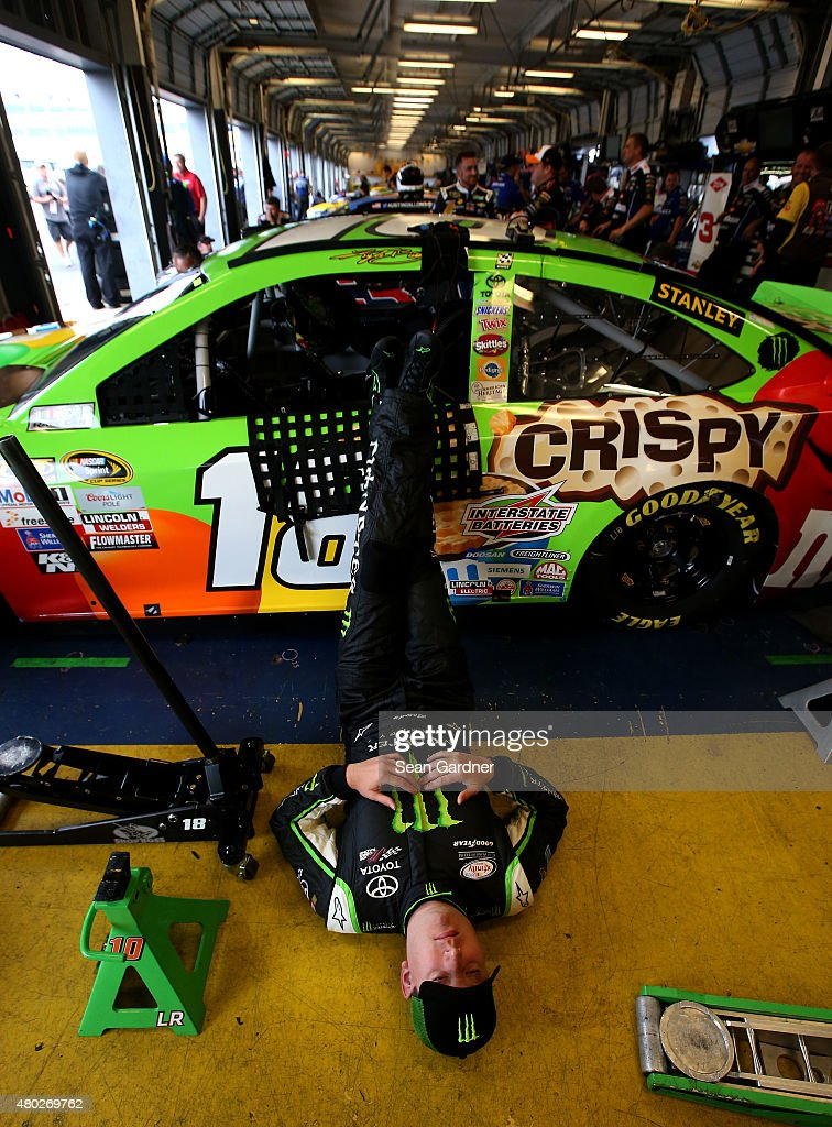 Kyle Busch, driver of the #18 M&M's Crispy Toyota, lies on the garage floor during a rain delay in practice for the NASCAR Sprint Cup Series Quaker State 400 Presented by Advance Auto Parts at Kentucky Speedway on July 10, 2015 in Sparta, Kentucky.