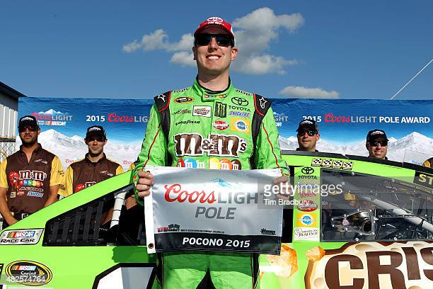 Kyle Busch driver of the MM's Crispy Toyota poses with the Coors Light Pole Award after qualifying for the pole for the NASCAR Sprint Cup Series...