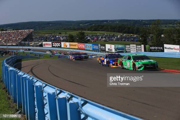 Kyle Busch driver of the MM's Crunchy Mint Toyota leads a pack of cars during the Monster Energy NASCAR Cup Series GoBowling at The Glen at Watkins...