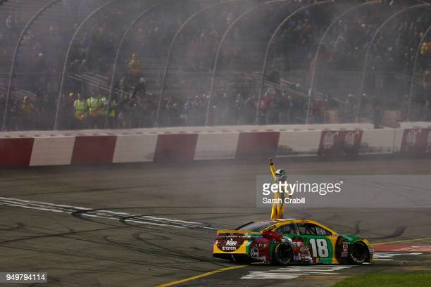 Kyle Busch driver of the MM's Flavor Vote Toyota celebrates after winning the Monster Energy NASCAR Cup Series Toyota Owners 400 at Richmond Raceway...