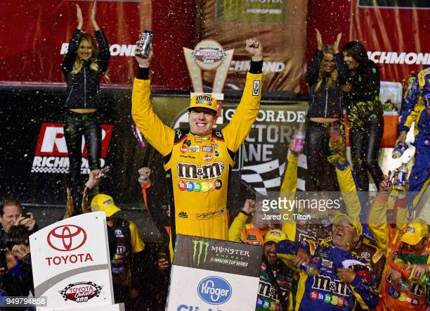 Kyle Busch driver of the MM's Flavor Vote Toyota celebrates in victory lane after winning the Monster Energy NASCAR Cup Series Toyota Owners 400 at...