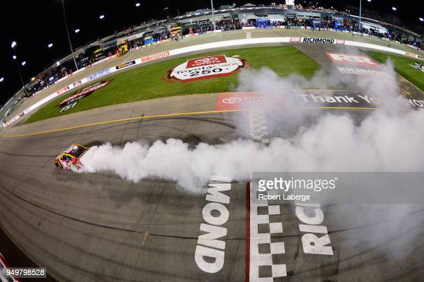 Kyle Busch driver of the MM's Flavor Vote Toyota celebrates with a burnout after winning the Monster Energy NASCAR Cup Series Toyota Owners 400 at...