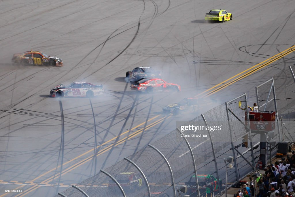 Kyle Busch, driver of the #18 M&M's Halloween Toyota, and Kevin Harvick, driver of the #29 Jimmy John's Chevrolet, wreck during the NASCAR Sprint Cup Series Good Sam Club 500 at Talladega Superspeedway on October 23, 2011 in Talladega, Alabama.