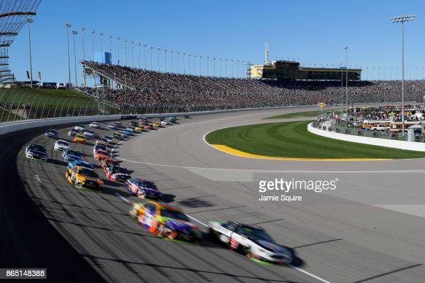 Kyle Busch, driver of the M&M's Halloween Toyota, and Kevin Harvick, driver of the Jimmy John's Ford, lead the field during a restart during the...