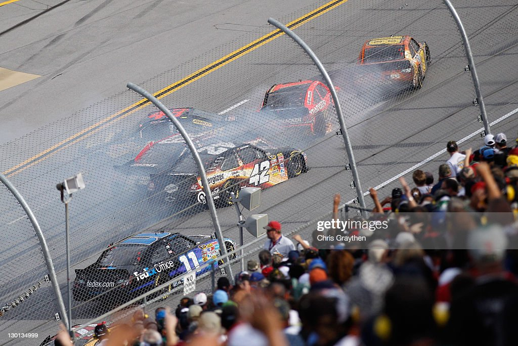 Kyle Busch, driver of the #18 M&M's Halloween Toyota, and others wreck on the front stretch during the NASCAR Sprint Cup Series Good Sam Club 500 at Talladega Superspeedway on October 23, 2011 in Talladega, Alabama.