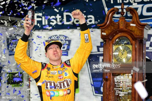 Kyle Busch driver of the MM's Halloween Toyota celebrates in Victory Lane after winning the Monster Energy NASCAR Cup Series First Data 500 at...
