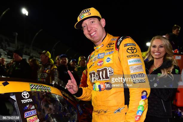 Kyle Busch driver of the MM's Halloween Toyota celebrates with the winner's decal in Victory Lane after winning the Monster Energy NASCAR Cup Series...