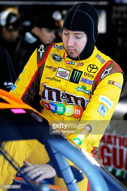 kyle busch driver of the mms halloween toyota climbs into his car in the garage area