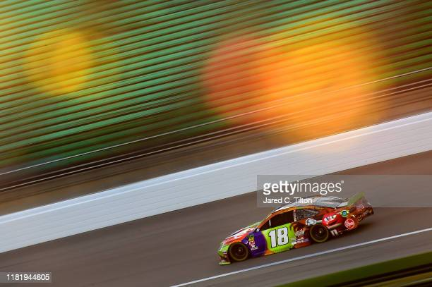 Kyle Busch, driver of the M&M's Halloween Toyota, practices for the Monster Energy NASCAR Cup Series Hollywood Casino 400 at Kansas Speedway on...
