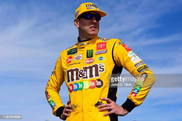Kyle Busch, driver of the M&M's Halloween Toyota, stands on the grid prior to the Monster Energy NASCAR Cup Series Hollywood Casino 400 at Kansas...
