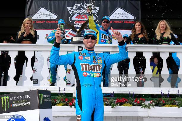 Kyle Busch driver of the MM's Hazelnut Toyota celebrates in Victory Lane after winning the Monster Energy NASCAR Cup Series Pocono 400 at Pocono...