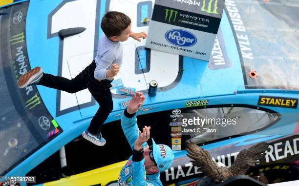 Kyle Busch driver of the MM's Hazelnut Toyota celebrates with his son Brexton in Victory Lane after winning the Monster Energy NASCAR Cup Series...