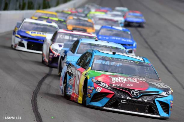 Kyle Busch driver of the MM's Hazelnut Toyota leads a pack of cars during the Monster Energy NASCAR Cup Series Pocono 400 at Pocono Raceway on June...