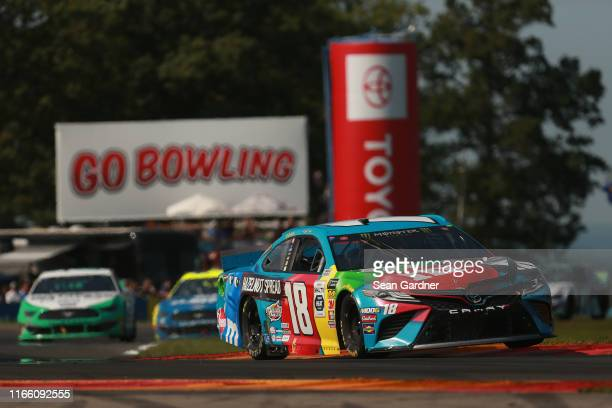 Kyle Busch, driver of the M&M's Hazelnut Toyota, leads a pack of cars during the Monster Energy NASCAR Cup Series Go Bowling at The Glen at Watkins...