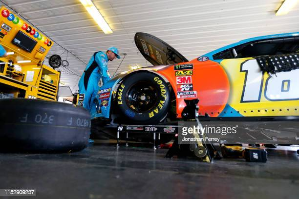 Kyle Busch driver of the MM's Hazelnut Toyota stands in the garage area during practice for the Monster Energy NASCAR Cup Series Pocono 400 at Pocono...