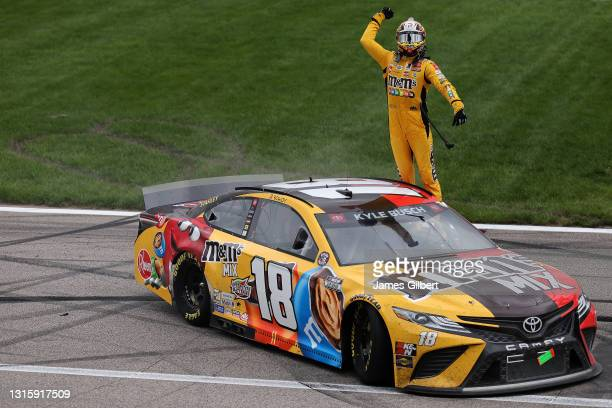 Kyle Busch, driver of the M&M's Mix Toyota, celebrates after winning the NASCAR Cup Series Buschy McBusch Race 400 at Kansas Speedway on May 02, 2021...
