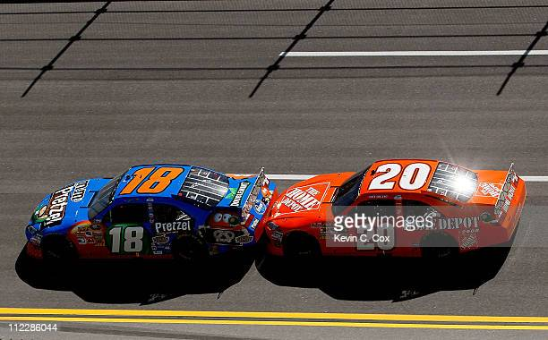 Kyle Busch driver of the MM's Pretzel Toyota leads Joey Logano driver of the The Home Depot Toyota during the NASCAR Sprint Cup Series Aaron's 499 at...