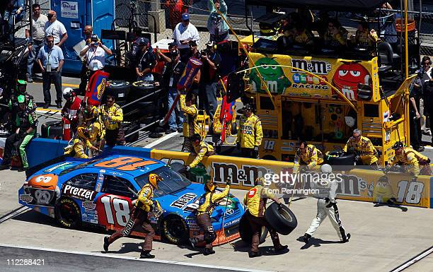 Kyle Busch driver of the MM's Pretzel Toyota makes a four tire pit stop during the NASCAR Sprint Cup Series Aaron's 499 at Talladega Superspeedway on...