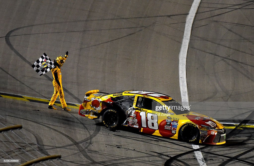 Kyle Busch, driver of the #18 M&M's Red Nose Toyocta, celebrates after winning the NASCAR Sprint Cup Series Go Bowling 400 at Kansas Speedway on May 7, 2016 in Kansas City, Kansas.