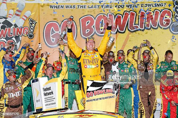 Kyle Busch driver of the MM's Red Nose Toyota celebrates after winning the NASCAR Sprint Cup Series Go Bowling 400 at Kansas Speedway on May 7 2016...