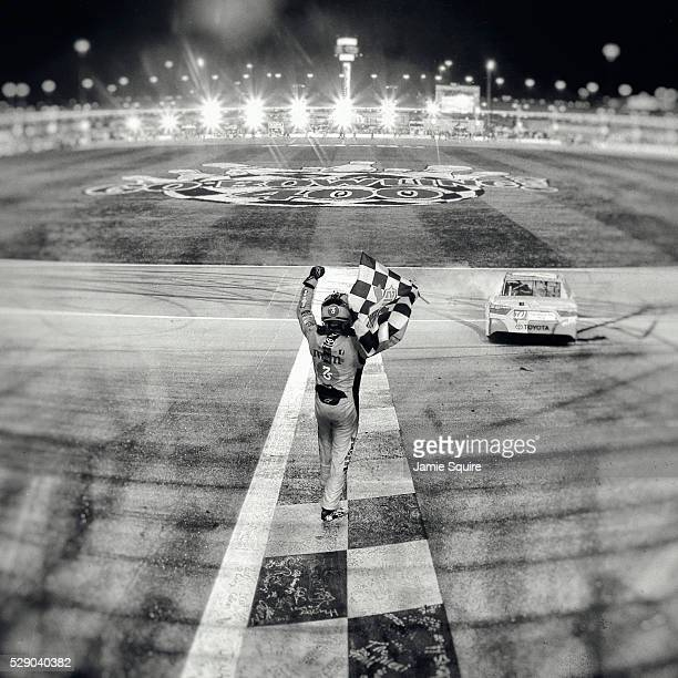 Kyle Busch, driver of the M&M's Red Nose Toyota, celebrates after winning the NASCAR Sprint Cup Series Go Bowling 400 at Kansas Speedway on May 7,...