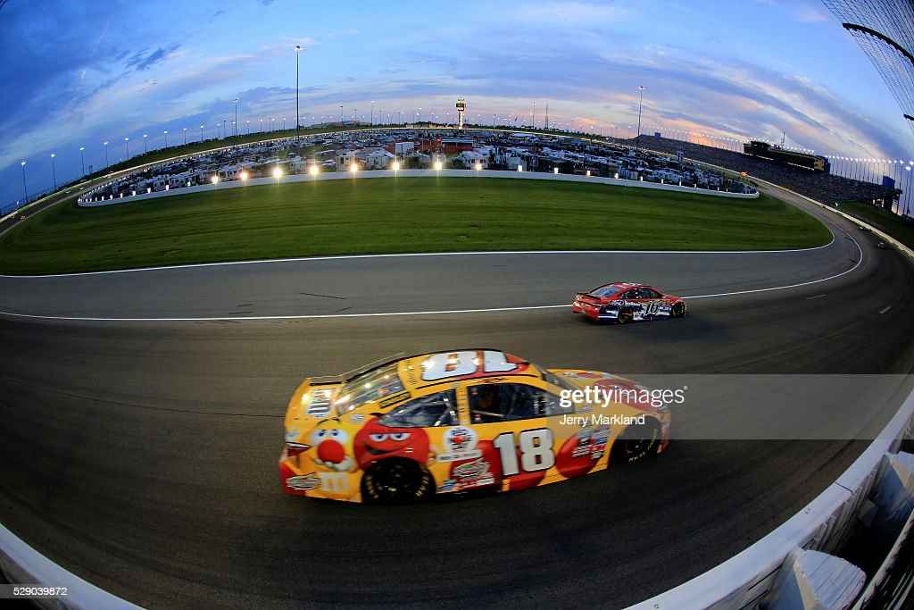 Kyle Busch, driver of the #18 M&M's Red Nose Toyota, races during the NASCAR Sprint Cup Series Go Bowling 400 at Kansas Speedway on May 7, 2016 in Kansas City, Kansas.