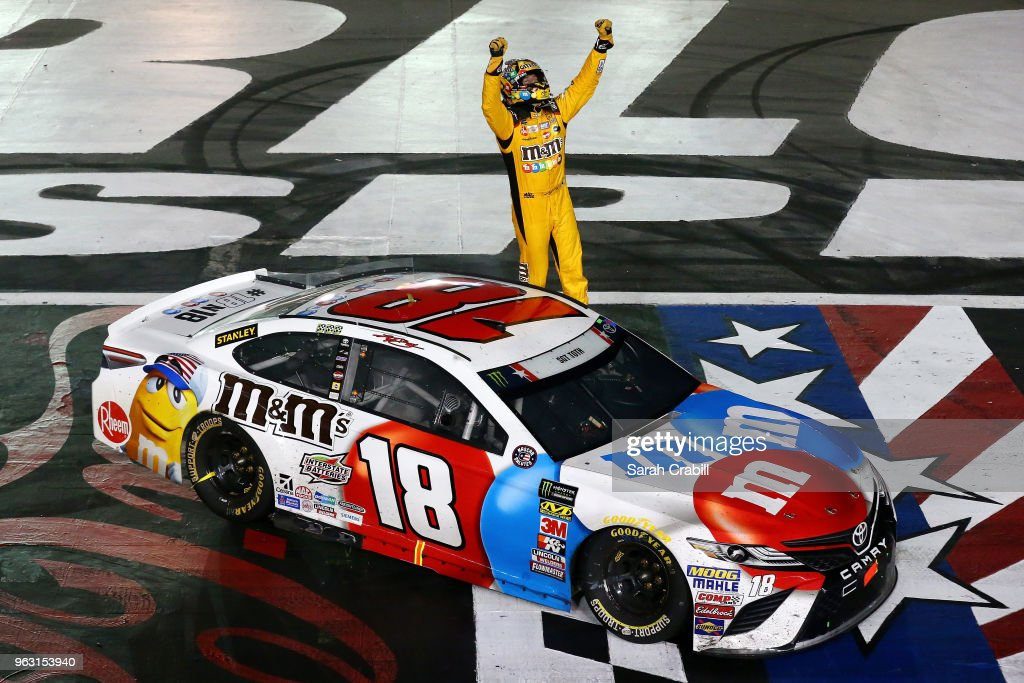Kyle Busch, driver of the #18 M&M's Red White & Blue Toyota, celebrates after winning the Monster Energy NASCAR Cup Series Coca-Cola 600 at Charlotte Motor Speedway on May 27, 2018 in Charlotte, North Carolina.