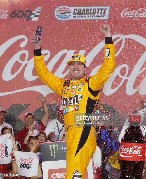 Kyle Busch driver of the MM's Red White Blue Toyota celebrates in victory lane after winning the Monster Energy NASCAR Cup Series CocaCola 600 at...