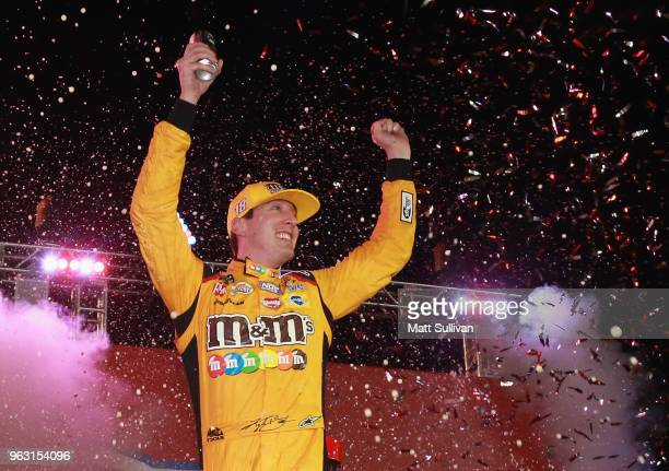 Kyle Busch, driver of the M&M's Red White & Blue Toyota, celebrates in victory lane after winning the Monster Energy NASCAR Cup Series Coca-Cola 600...