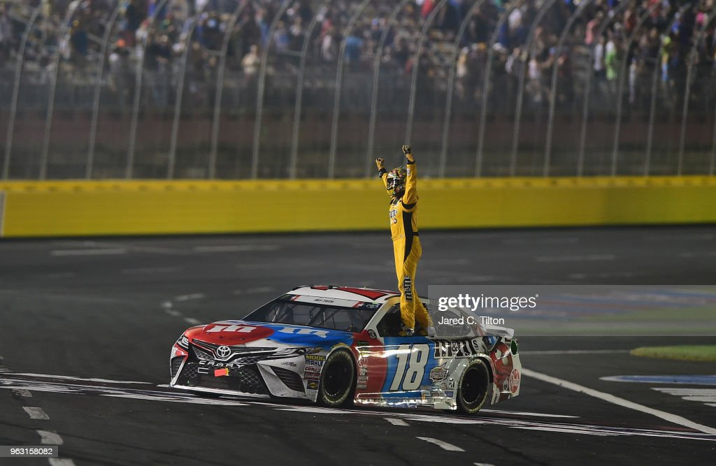 Kyle Busch, driver of the #18 M&M's Red White & Blue Toyota, celebrates with the checkered flag after winning the Monster Energy NASCAR Cup Series Coca-Cola 600 at Charlotte Motor Speedway on May 27, 2018 in Charlotte, North Carolina.
