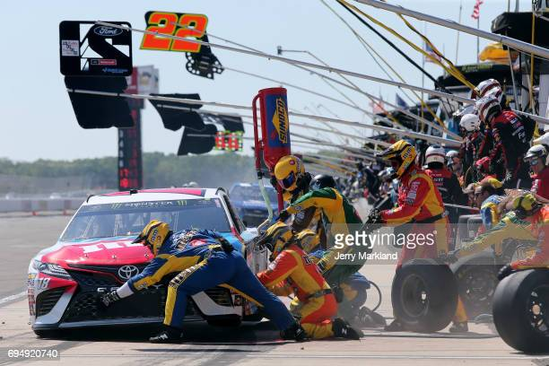 Kyle Busch driver of the MM's Red White Blue Toyota pits during the Monster Energy NASCAR Cup Series Axalta presents the Pocono 400 at Pocono Raceway...