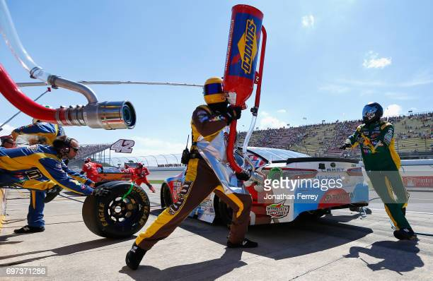 Kyle Busch driver of the MM's Red White Blue Toyota pits during the Monster Energy NASCAR Cup Series FireKeepers Casino 400 at Michigan International...