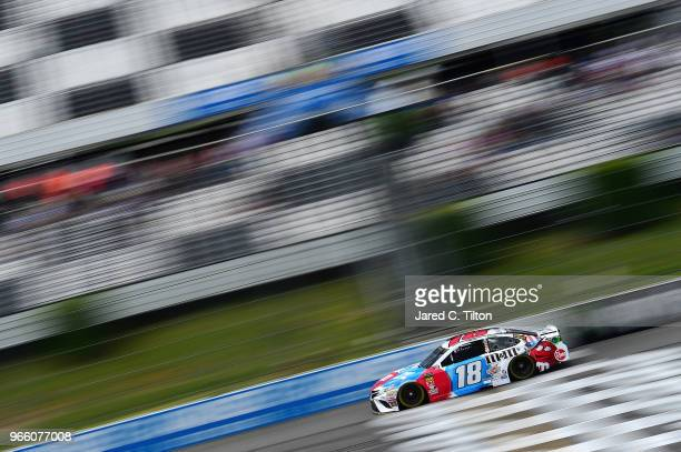 Kyle Busch driver of the MM's Red White Blue Toyota practices for the Monster Energy NASCAR Cup Series Pocono 400 at Pocono Raceway on June 2 2018 in...